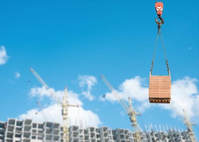 Crane at a construction site a new home